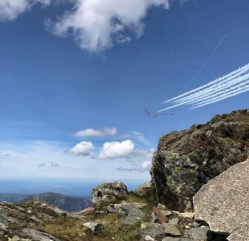 mountains overlooking an airplane show