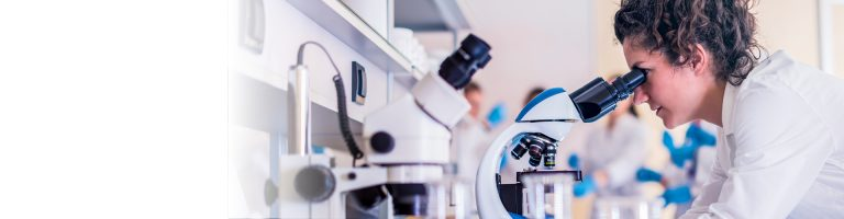 Woman logging through microscope