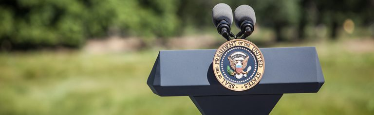 A podium with the seal of the President of the United States