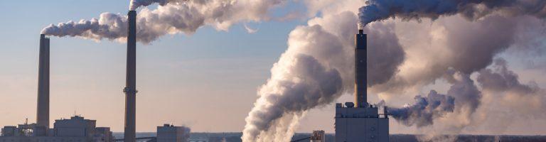 Huge smoking chimneys in the factory