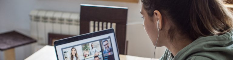 Woman talking with people via internet communicator