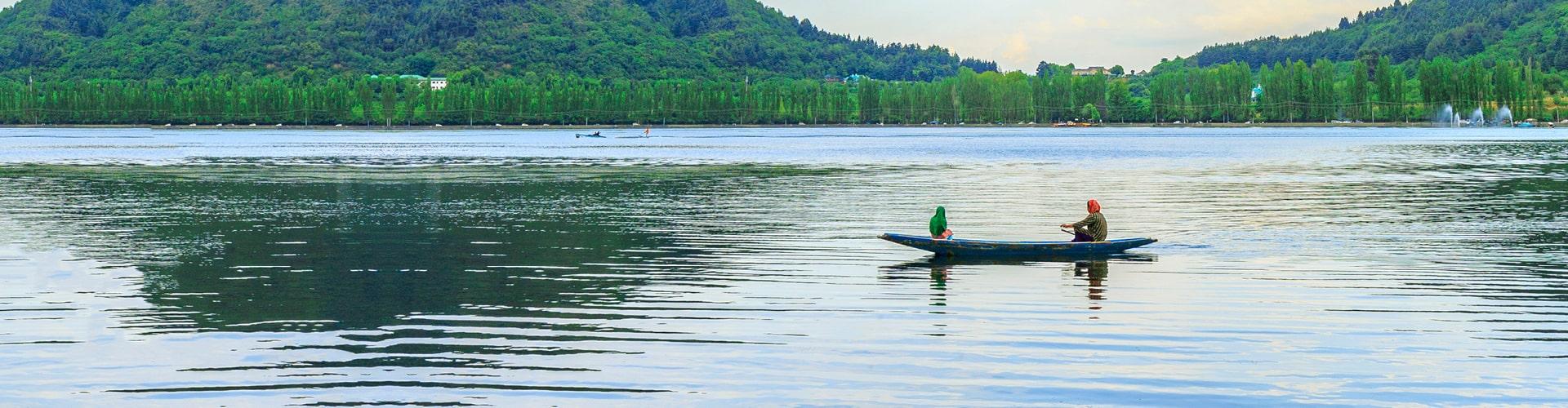 Hindu women rowing a skiff