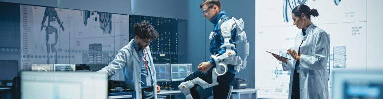 Scientists Testing Movements Of A Man In A Robotic Suit