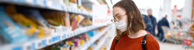 Coronavirus update woment in shop wearing mask