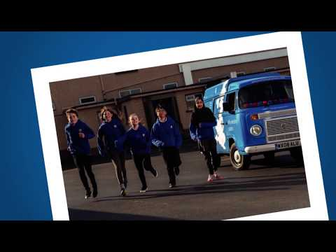 The group of teenagers background blue bus