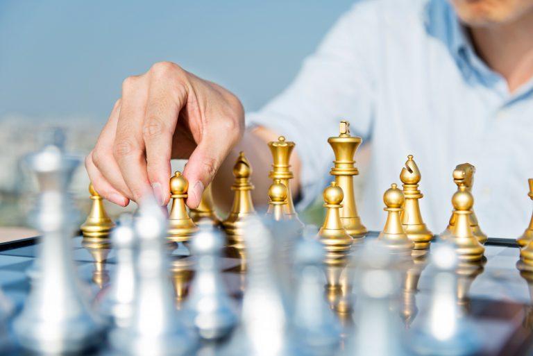 Man playing gold chess
