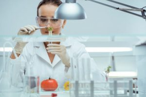 Woman doing food test in laboratory