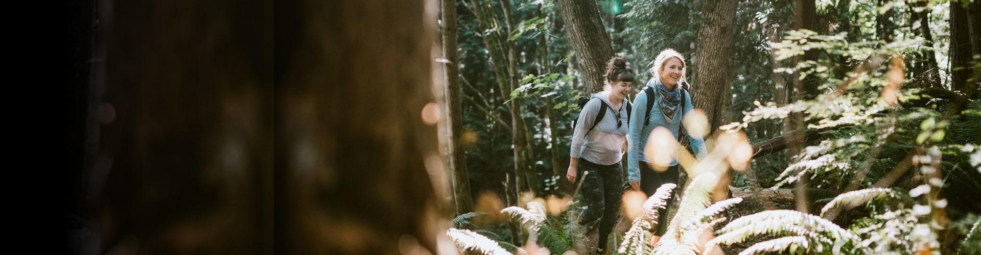 Two women walking in forest