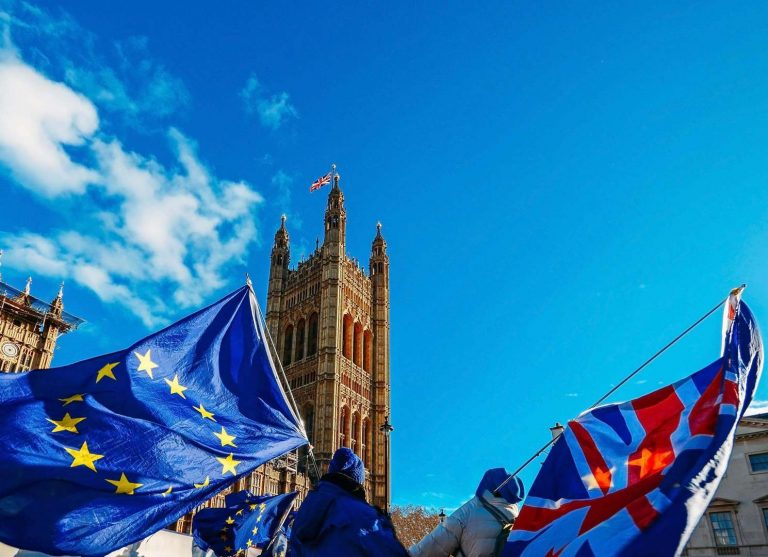 European Union and British Union Jack flag flying in front of Houses of Parliament at Westminster Palace, London