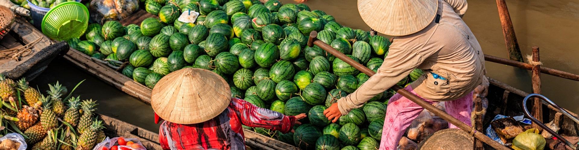 Women selling fruit on floating market