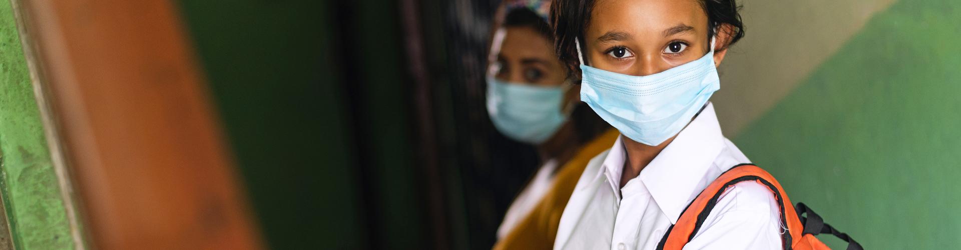 Indian girl wearing medical mask