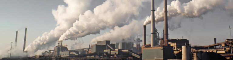 Wind blowing pollution from a coal burning power plant